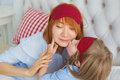 Little daughter kiss her mother before a sleep Royalty Free Stock Photo
