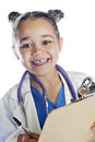 Little doc taking notes closeup image of an elementary doctor happily looking beyond her clipboard with a pen in her hand on a Royalty Free Stock Photos