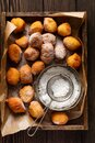 Little Donuts. Home-made cottage cheese cookies fried in deep fat and sprinkled with icing sugar in a vintage wooden box tray agai Royalty Free Stock Photo