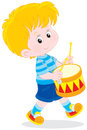 Little drummer boy beats his toy colorful drum Stock Photography