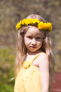 Little fair-haired girl in dandelion wreath Royalty Free Stock Image