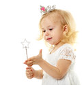 Little fairy with magic wand blond girl as a princess and tiara isolated on white background Stock Photo