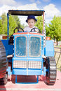 Little Farmer on Tractor Royalty Free Stock Photo