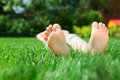 Little feet on the grass Royalty Free Stock Photo