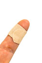 Little finger with band-aid Stock Photo