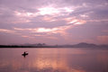 Little fish boat in the nightfall a fisherman fishing on river Stock Images