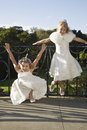 Little flower girls waiting for wedding ceremony full length portrait of two Royalty Free Stock Photo