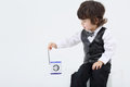 Little focused boy touches antenna of portable radio on white background Stock Photography