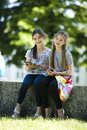 Little friends with PC tablet and mobile phone Stock Photography