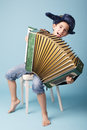 Little funny accordion player Royalty Free Stock Photo