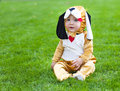 Little funny baby wearing puppy suit