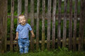 Little funny boy with fence Royalty Free Stock Photo