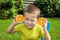 Little funny boy with orange healthy nutrition concept Royalty Free Stock Photo