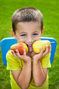 Little funny boy with pears healthy nutrition concept Royalty Free Stock Photo