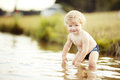 Little funny boy in summer lake Royalty Free Stock Photography