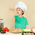 Little funny chef expressive enjoys cooked pizza a Stock Images