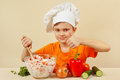 Little funny chef prepared salad of fresh vegetables Royalty Free Stock Photo