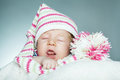 Little funny sleepeng baby cute with hat Stock Images
