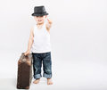 Little gentleman with huge suitcase brown Stock Photo