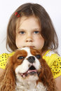 Little girl 5 years old and the dog isolated Stock Photos