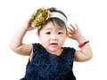 Little girl adjust hair accessory isolated Stock Photo