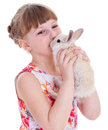 Little girl with adorable rabbit pet child portrait of happy isolated on white background Stock Image