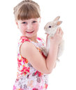 Little girl with adorable rabbit pet child portrait of happy isolated on white background Stock Photography