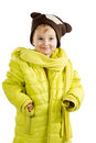 Little girl in adult jacket and hat blond dressed light green with a scarf brown isolated on a white background Stock Image