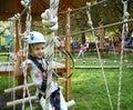 Little girl in adventure park Stock Photo