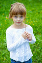 Little girl against a green grass in the spring Royalty Free Stock Photos