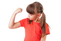 Little girl appreciates the size of biceps Royalty Free Stock Photos