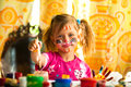 Little girl artist with paint of face Stock Photography