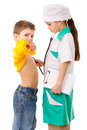 Little girl as doctor are listening a boy in costume do s lungs playing with stethoscope isolated on white Stock Photos