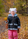 Little girl  in autumn park. Royalty Free Stock Image