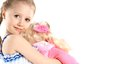 Little girl with baby doll toy on a white background Stock Images