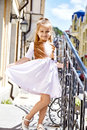 Little girl baby face cute and pretty walk on the street sun Royalty Free Stock Photo