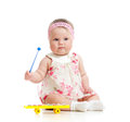 Little girl baby playing with musical toy Royalty Free Stock Photo