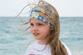 Little girl on a background of blue sea shooting in spain santa susanna Stock Images