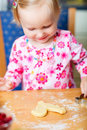 Little girl baking cookies Stock Photos