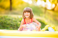 Little girl with ball in the garden swimming pool. Royalty Free Stock Photo