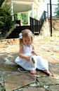 Little Girl and Ballet Slippers Royalty Free Stock Photo