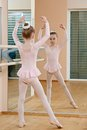 Little girl at ballet training in suit exercise in front of mirror Royalty Free Stock Photography