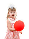 Little girl with balloon surprised red isolated on the white background Stock Photos