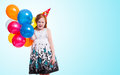 Little girl with balloons on blue background Royalty Free Stock Photo