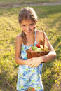 Little girl with basket of fresh fruit happy child Royalty Free Stock Image