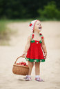 Little girl with basket full of strawberries happy Stock Image