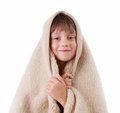 Little girl is basking under a blanket Stock Image