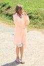 Little girl in bathrobe blond smiling wet kid pink Stock Photo