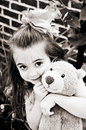 Little Girl with Bear in Brown Tones Royalty Free Stock Photo