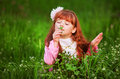 Little girl in a beautiful dress lush garden Royalty Free Stock Photo